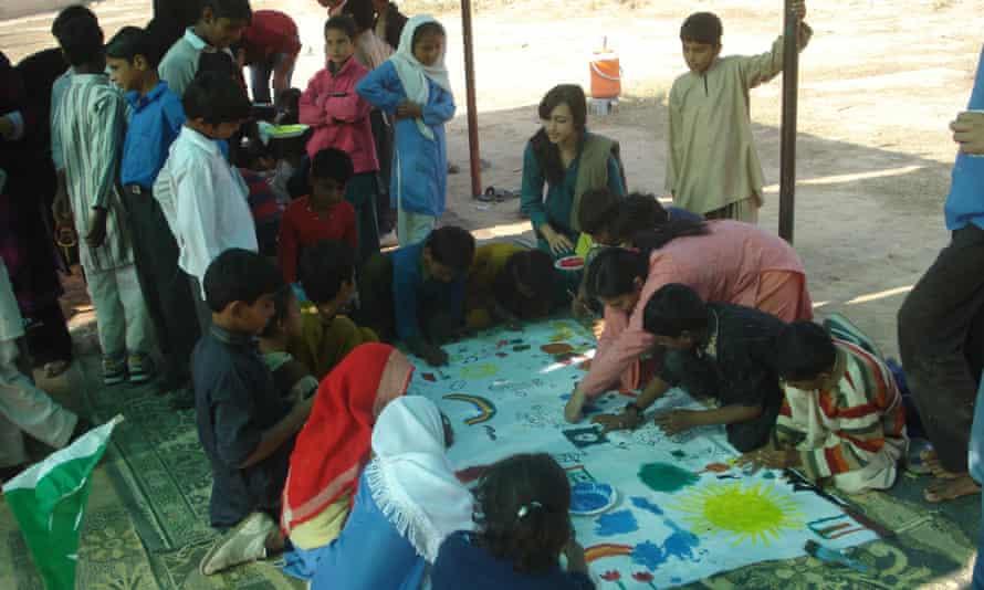 painting in school slums Pakistan