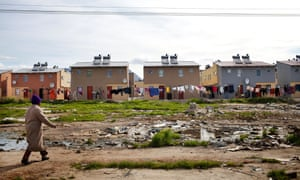 Cape Town South Africa - Washing hangs behind a newly developed RDP housing project in Langa where all houses are equipped with solar heaters.