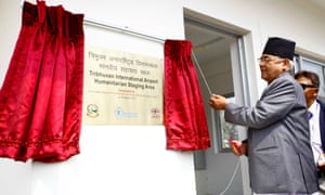 Deputy Prime Minister and Home Minister of Nepal Bamdev Gautam (L) inaugurates the first Humanitarian Staging Area at Tribhuvan International Airport in Kathmandu, Nepal, March 26, 2015. The United Nations World Food Programme (WFP) and the Ministry of Home Affairs and Civil Authority of Nepal inaugurated the country's first Humanitarian Staging Area here on Thursday.