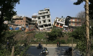 Damaged buildings lean to their sides in Kathmandu, Nepal, Monday, April 27, 2015. A strong magnitude 7.8 earthquake shook Nepal's capital and the densely populated Kathmandu Valley on Saturday, causing extensive damage with toppled walls and collapsed buildings.