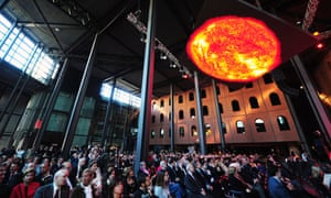 A sun is displayed on a screen during the inauguration ceremony of the new cultural centre the Alhondiga Bilbao designed by French architect Philippe Starck.