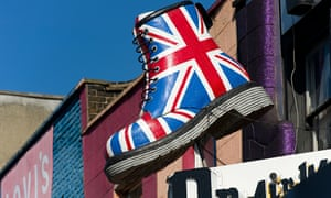 Giant Dr Marten's boot with union jack over shop