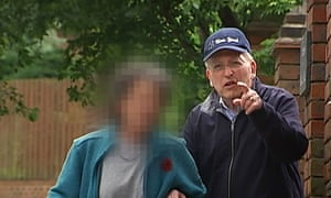 Lord Janner (right) filmed outside his house in in 2014. The peer was diagnosed with Alzheimer's disease in 2009 and requires round-the-clock care.