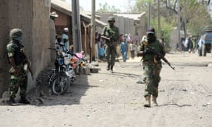 Soldiers walking in the street in the remote northeast town of Baga, Borno State