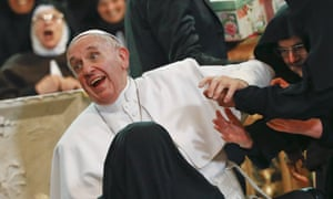 Pope Francis reacts as he is greeted by cloistered nuns at the Duomo during his pastoral visit in Naples
