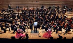 The North Korean Unhasu orchestra and musicians from the Radio France Philharmonic Orchestra at a 2012 rehearsal in the Salle Pleyel concert hall in Paris.