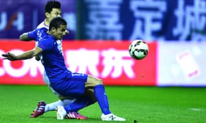 Tim Cahill, in the blue of Shanghai Shenhua, has been one of the standard bearers for the growing foreign influence in Chinese football.