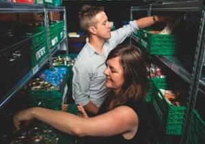 Sarah Chapman and Dan Frith sort donations at Wandsworth food bank