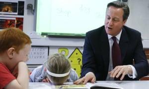 the prime minister, David Cameron, with schoolchildren