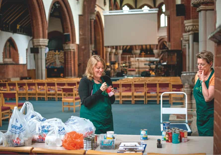 Food bank volunteers sort goods arriving from donors at St Mark's Church in Clapham, south London