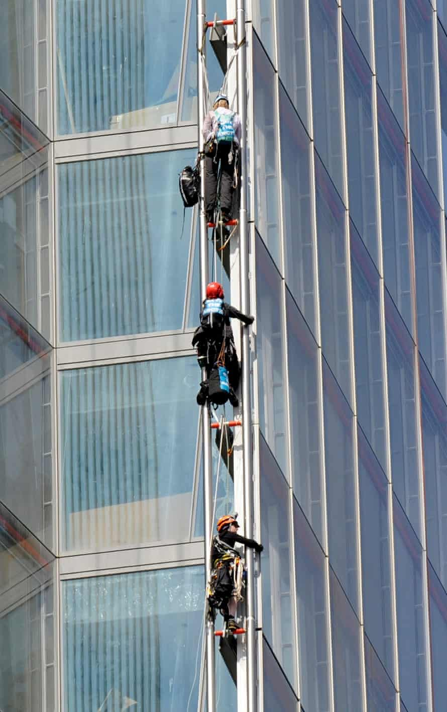 Three of the Greenpeace activists mid-ascent.
