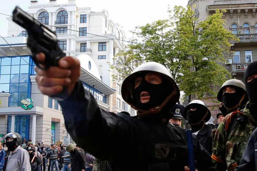 A pro-Russia activist aims a pistol at supporters of the Kiev government during clashes in the streets of Odessa, 2 May 2014.