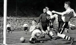 Blackpool's Stan Mortensen falls to the ground as he scores his side's second goal on his way to completing a hat-trick in the 1953 FA Cup final.