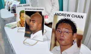 Photographs of convicts Andrew Chan and Myuran Sukumaran, two members of the Bali Nine, are displayed at the hospital morgue in Jakarta.