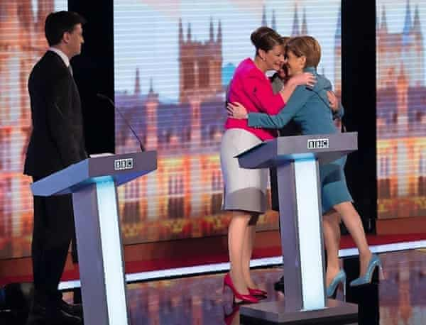 Nicola Sturgeon embracing Plaid Cymru's Leanne Wood and the Green party's Natalie Bennett, watched by Ed Miliband, at the BBC challengers election debate