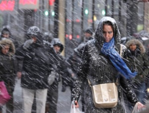 Pedestrians make their way through snow in New York on Jan. 26, 2015. More than 35 million people along the Philadelphia-to-Boston corridor rushed to get home and settle in as a fearsome storm swirled in.