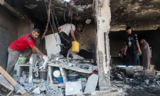 Palestinians recover possessions from the ruins of their home during a truce in the 2014 Gaza war.