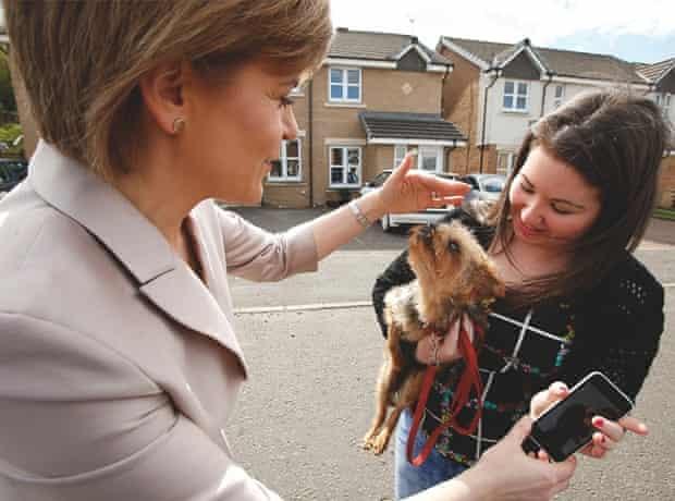 Nicola Sturgeon with a woman and a dog