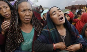 Villagers plead for food after an aid helicopter landed at the remote mountain village of Gumda, Gorkha district, Nepal.