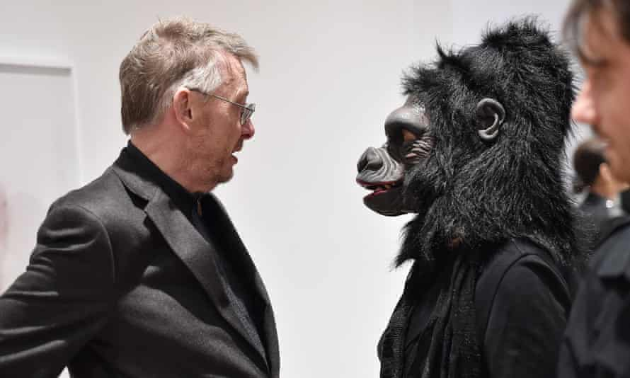 A Guerrilla Girl with Whitney Museum curator David Kiehl