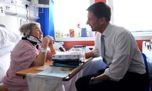 Jeremy Hunt meets a patient, Monica Kneebone, at Kings College hospital in London.