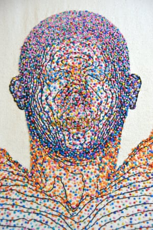 Symbiosis by Rebecca D. Harris. An embroidered body map of microbes.