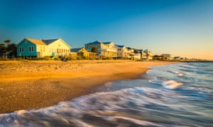 Waves in the Atlantic Ocean and morning light on beachfront homes at Edisto Beach, South Carolina