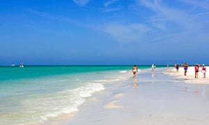 People walking along the beach at Siesta Key Florida