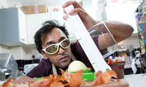 Rhik chops an onion with the Alligator Onion Cutter and John Lewis Onion Goggles