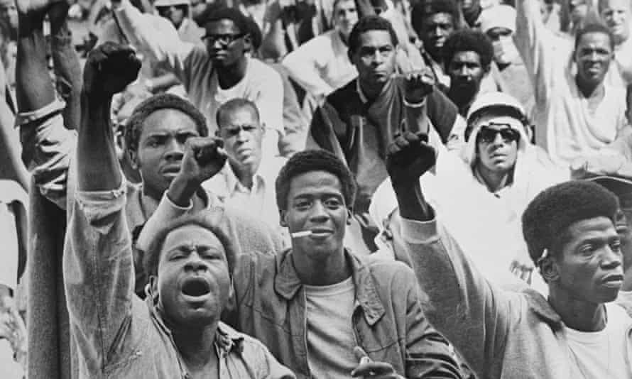 Inmates at the Attica correctional cacility give the black power salute