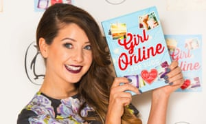 YouTube star Zoe Sugg, aka Zoella, at the launch party for her book Girl Online, which she is holding.