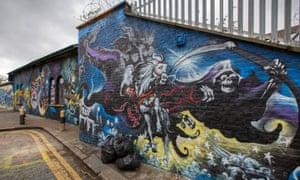Detail from a Terry Pratchett mural in an alleyway off Brick Lane, London