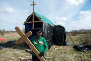 Ethiopian migrants have built a church using plastic sheeting and wood from pallets