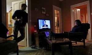 People watch the seven leaders debate on television in Portstewart