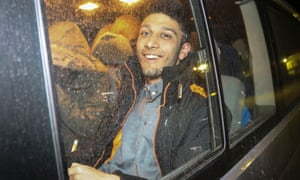 Waheed Ahmed, the son of Rochdale councillor Shakil Ahmed, leaves hospital after a medical checkup and fingerprinting in Hatay province, Turkey.