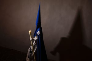 A penitent casts his shadow as he takes part in a Holy Week procession in Arcos de la Frontera, Spain. Hundreds of processions take place throughout Spain during the Easter Holy Week