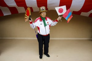 A supporter holds the Japanese and Mongolian national flags