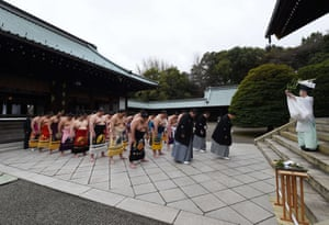 A Shinto priest purifies the heads of the Japan Sumo Association and sumo wrestlers during a traditional Shinto ceremony at the Yasukuni shrine in Tokyo.