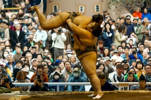 Sumo wrestlers perform a show fight.