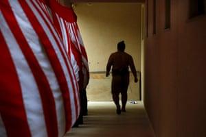 A sumo wrestler enters the arena.
