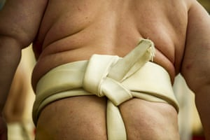 A sumo wrestler wears a mawashi loincloth during a warm-up bout.