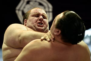 Sumo wrestlers Gagamaru from Georgia, left, and Japanese Toyohibiki compete.