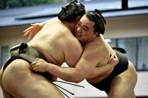 epa04691002 Sumo wrestlers Mongolian yokozuna (grand champions) Hakuho (L) and Harumafuji compete during the 'Honozumo', a ceremonial sumo tournament at the Yasukuni Shrine precincts i