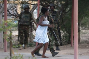 A woman is rescued from Garissa university where she had been held hostage by al-Shabaab Islamist militants. The attack on the university in north east Kenya left at least 147 people dead and 79 injured, Kenyan officials said. All four of the al-Shabaab militants who carried out the attack were killed