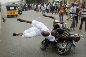 Followers of the presidential candidate Muhammadu Buhari and his All Progressives Congress crash into another supporter during celebrations in Kano. Nigeria's opposition APC declared an election victory for former military ruler Buhari and said Africa's most populous nation was witnessing history with its first democratic transfer of power