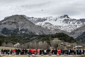 Seyne villagers and Red Cross personnel pay tribute to the victims of the Germanwings Airbus A320 crash in the village of Le Vernet, French Alps. Andreas Lubitz, the co-pilot believed to have deliberately crashed flight 4U9525, did online research into cockpit doors and suicide methods in the days leading up to the crash, according to Düsseldorf prosecutors