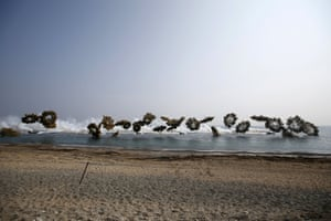 Amphibious assault vehicles of the South Korean Marine Corps throw smoke bombs as they land on shore during a US-South Korea manoeuvre in Pohang. The drill is part of the two countries' annual military training called Foal Eagle