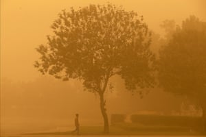 A man is photographed during a sandstorm in Dubai. The storm which originated from Kuwait and Saudi Arabia caused disruption to flights from the country's international airports