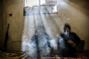 In the final photograph this week, we return to Kobane where two Kurdish fighters rest in a house on the outskirts of the ravaged Syrian town