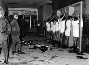 Student protesters are held at gunpoint by soldiers inside an apartment building in Tlatelolco, Mexico City.